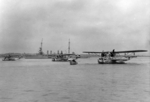 P2Y aircraft of US Navy squadron VP-10F with an Omaha-class light cruiser, possibly at Panama Canal Zone, 1933-1937