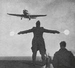 British Skua aircraft approaching a carrier for landing, date unknown