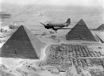 US Air Transport Command C-47 Skytrain aircraft flying over the Giza Necropolis in Egypt, 1943