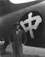 Ethnically-American pilot working for China National Aviation Corporation posing in front of a C-47 Skytrain aircraft, China, circa late 1940s