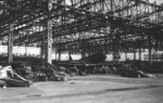 Destroyed aircraft hangar at Omura, Sasebo Naval District, Japan, late 1945; note L2D aircraft in center