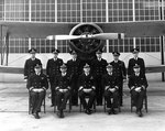 Rear Admiral Charles A. Blakeley of US Navy Carrier Division Two and his staff posed before SOC Seagull aircraft, Naval Air Station, Norfolk, Virginia, United States, 14 Jan 1938