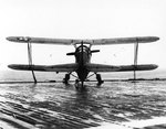 SOC-3A Seagull floatplane of US Navy Scouting Squadron 201 (VS-201) parked on the deck of escort carrier Long Island, 16 Dec 1941, photo 3 of 3