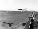 SOC-3A Seagull aircraft landing on escort carrier Long Island, 17 Jun 1942
