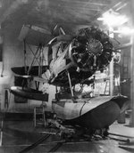 SOC-3 Seagull aircraft stripped for maintenance in the hangar of light cruiser Savannah, 1938; note Pratt and Whitney R-1340 9-cylinder radial engine