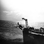 SOC Seagull aircraft being recovered by cruiser Philadelphia, off North Africa, Nov 1942, photo 2 of 4
