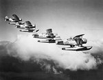 SOC-3 scout-observation floatplanes off cruiser Honolulu flying in formation, circa 1938-1939