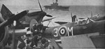 Spitfire Mk. VC aircraft aboard USS Wasp, en route to Malta in the Mediterranean Sea, mid-1942; note HMS Eagle in background