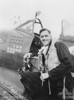 Australian Group Captain Clive R. Caldwell of No. 80 (Fighter) Wing RAAF next to his Spitfire Mk VIII aircraft, Halmahera, Morotai Islands, Dutch East Indies, circa Dec 1944
