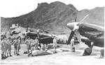 Spitfire F.24 fighters of No. 80 Squadron RAF at Royal Navy station HMS Flycatcher (later Kai Tak Airport then Hong Kong International Airport), Hong Kong, Nov 1949