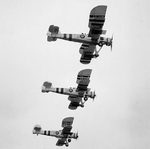 Three Swordfish aircraft, equipped with rockets, performing a training flight from St. Merryn Royal Naval Air Station, United Kingdom, 1 Aug 1944