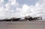 Crews providing maintenance to PV-1 Ventura patrol bombers of US Navy squadron VPB-147 at NAS Isla Grande, San Juan, Puerto Rico, Jun 1944; note rocket rails mounted under the wings