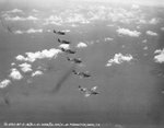 Six P-40 Warhawk fighters based at Hickam Field in flight over Oahu, US Territory of Hawaii, 1 Aug 1941, photo 2 of 2