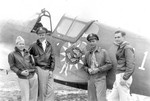 American airmen with a P-40E Kittyhawk fighter in China, date unknown