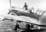 American pilot posing with his P-40E Kittyhawk fighter in China, date unknown; note 5 Japanese flags noting 5 kills