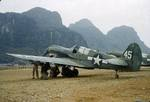P-40N Warhawk fighters of the 74th Fighter Squadron (direct descendent of the AVG Flying Tigers) in China, probably Kweilin (now Guilin) 1943-44. Note rocket tubes being mounted under the wing.