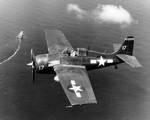 FM-2 Wildcat flying combat air patrol over USS Santee, during the Leyte Invasion, 20 Oct 1944