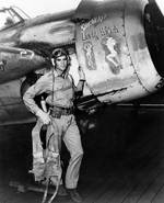 Ensign Darrell Bennett stood beside his FM-2 Wildcat