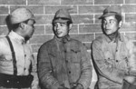 Chinese soldier speaking with two Japanese prisoners of war, Changsha, Hunan Province, China, Jan 1942