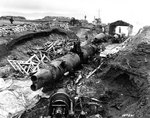 Three Japanese Type A-class midget submarines wrecked by demolition charges, at a former Japanese base on Kiska Island, Aleutian Islands, 7 Sep 1943, photo 1 of 2