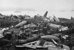 Wrecked Japanese aircraft, oil drums, and other rubble at Kiska, Aleutian Islands, US Territory of Alaska, 19 Aug 1943