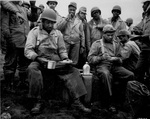 African-American soldiers of the labor battalion deployed by the US Army eating a meal in the field, Massacre Bay, Attu, Aleutian Islands, US Territory of Alaska, 20 May 1943