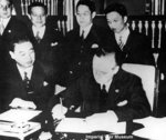 Joachim von Ribbentrop signing the Anti-Comintern Pact, Berlin, Germany, 25 Nov 1936; Japanese ambassador to Berlin Kintomo Mushakoji watching