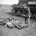 British soldier preparing ammunition for a M7 Priest self-propelled gun, Anzio, Italy, 31 Jan 1944