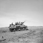 British Priest self-propelled gun in action, Anzio, Italy, 31 Jan 1944