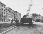 US infantry running past a burning tank, Rome, Italy, 4 Jun 1944