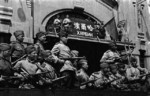 Soviet troops flying the red flag atop the train station at Harbin, Songjiang, China, circa 20 Aug 1945, photo 2 of 2