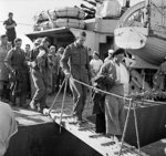 Wounded British troops disembarking at an Egyptian port after being evacuated from Crete, Greece, 31 May 1941