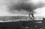 A pall of smoke hanging over the harbor in Souda Bay, Crete, Greece where two ships, hit by German bombs, were burning, 25 Jun 1941, photo 1 of 2