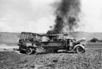 A British truck and trailer burning after attacked by German Luftwaffe aircraft, Crete, Greece, 25 Jun 1941