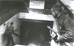 Russian soldiers with PPSh-41 submachine guns entering the Frankfurter Allee station in Berlin, Germany, late-Apr 1945