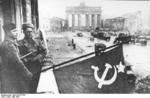Soviet troops flying a flag atop Hotel Adlon on Unter den Linden, Berlin, Germany, May 1945