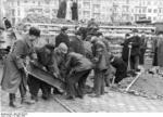 German civilians building a roadblock near the Hermannstraße S-Bahn station, Berlin, Germany, 10 Mar 1945, photo 3 of 6