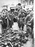 German troops surrendering their weapons near a subway entrance, Berlin, Germany, 2 May 1945
