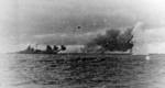 Bismarck firing on Hood and Prince of Wales, Battle of Denmark Strait, 24 May 1941, photo 4 of 8; photographed from Prinz Eugen, note shells from Prince of Wales splashing short and Bismarck listing b