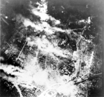 Aerial view of Tokyo following bombing by B-29 Superfortress bombers, night of 26 May 1945