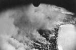 District of Tarumiza at Kagoshima, Kyushu, Japan under attack by aircraft of 499th Bomb Squadron, US 345th Bomb Group, 17 Jun 1945