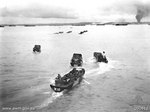 Men of the Australian 2/48 Infantry Battalion in landing craft, Tarakan, Borneo, 1 May 1945