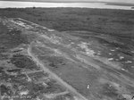 View of airstrip on Tarakan, Borneo, showing extensive damage sustained during battle and some reconstruction efforts commited by 1st and 8th Airfield construction Squadrons of RAAF, 21 May 1945