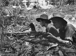 Private D. E. Hailey and T. M. Conway of the Australian 2/23 Infantry Battalion in their Bren gun pit on the forward slope of B Company position, Tarakan, Borneo, May 1945