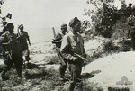 Men of the Royal Netherlands Indies Army Forces conducting mop-up operations on Tarakan, Borneo, late May 1945