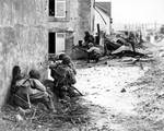 Men of US Army 2nd Infantry Division advancing into Brest, France under German machine gun fire, 9 Sep 1944