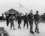 German officer prisoners being led back after talk with Allied officers near Brest, France, Sep 1944