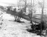 Two soldiers of US 101st Airborne Division manning a forward post near a road, near Bastogne, Belgium, 23 Dec 1944
