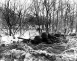 Machine gun post manned by men of 1st Battalion, 157th Regiment, US 45th Division, Niederbronn-les-Bains, France, 10 Dec 1944; note M1919 Browning machine gun