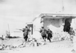 Australian troops rushing through the streets of Bardia, Libya, 4 Jan 1941